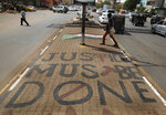 A slogan written by the opposition is painted on a sidewalk in Khartoum, Sudan, Wednesday, June 19, 2019. Sudan's military council is urging protest leaders to resume negotiations on the transition of power, but says talks