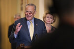 Senate Minority Leader Chuck Schumer, D-N.Y., joined at right by Sen. Debbie Stabenow, D-Mich., speaks to reporters during a news conference at the Capitol in Washington, Tuesday, Sept. 17, 2019. (AP Photo/J. Scott Applewhite)