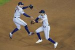Houston Astros' George Springer and Carlos Correa celebrate after Game 4 of the baseball World Series against the Washington Nationals Sunday, Oct. 27, 2019, in Washington. The Astros won 8-1 to tie the series 2-2. (AP Photo/Pablo Martinez Monsivais)