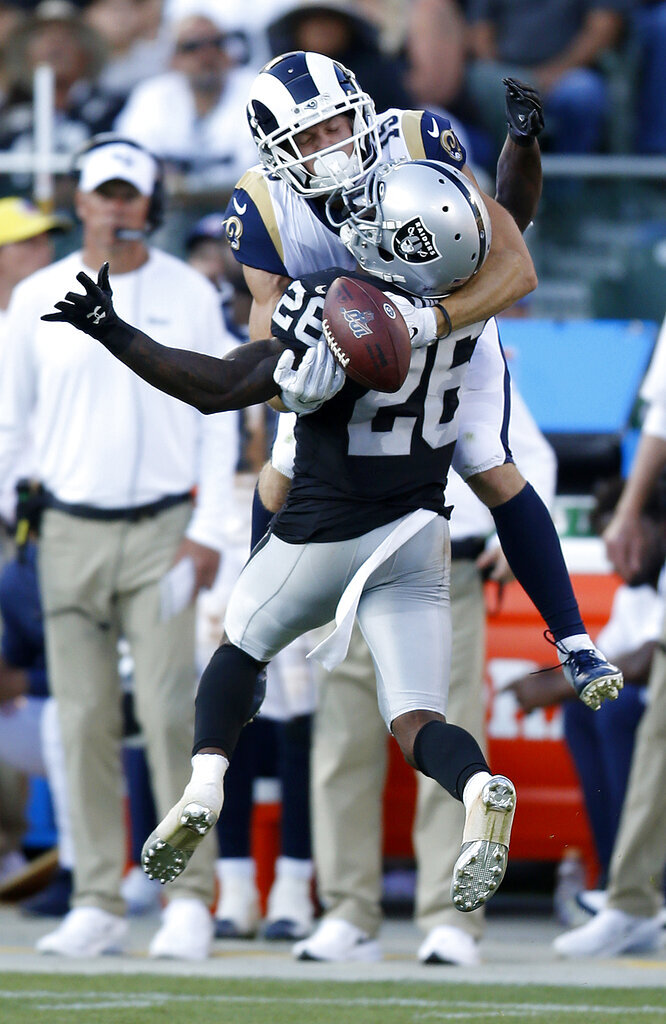 Oakland Raiders' Nevin Lawson (26) breaks up a pass intended for Los Angeles Rams' Alex Bachman in the second half of a preseason NFL football game Saturday, Aug. 10, 2019, in Oakland, Calif. (AP Photo/D. Ross Cameron)
