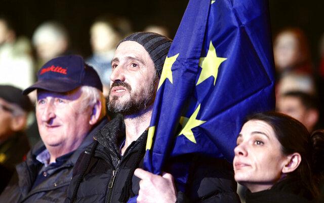 A man holds an EU flag during a rally titled