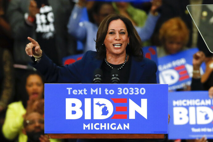 """FILE - In this March 9, 2020, file photo, Sen. Kamala Harris, D-Calif., speaks at a campaign rally for Democratic presidential candidate former Vice President Joe Biden at Renaissance High School in Detroit. Before Joe Biden named Harris his running mate, women's groups were readying a campaign of their own: Shutting down sexist coverage and disinformation about a vice presidential nominee they say is headed for months of false smears and """"brutal"""" attacks from internet haters.  (AP Photo/Paul Sancya, File)"""