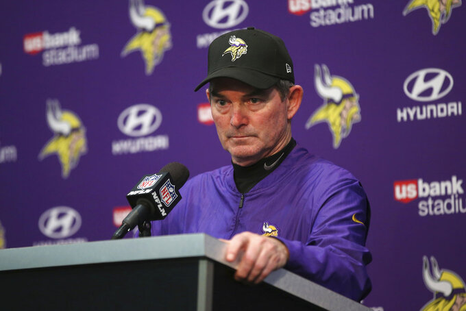 FILE - In this Dec. 30, 2018, file photo, Minnesota Vikings head coach Mike Zimmer speaks during a news conference after an NFL football game against the Chicago Bears, in Minneapolis. Zimmer's fifth season as head coach of the Vikings ended with plenty of questions about the team's direction and without the playoffs. (AP Photo/Jim Mone, File)