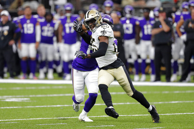 FILE - In this Aug. 9, 2019, photo, New Orleans Saints cornerback Eli Apple (25) shrugs off a block in the first half of an NFL preseason football game against the Minnesota Vikings in New Orleans. The Carolina Panthers have agreed to terms with free agent cornerback Apple. The move gives the Panthers the experienced cornerback they coveted after James Bradberry signed as a free agent with the Giants. (AP Photo/Bill Feig)