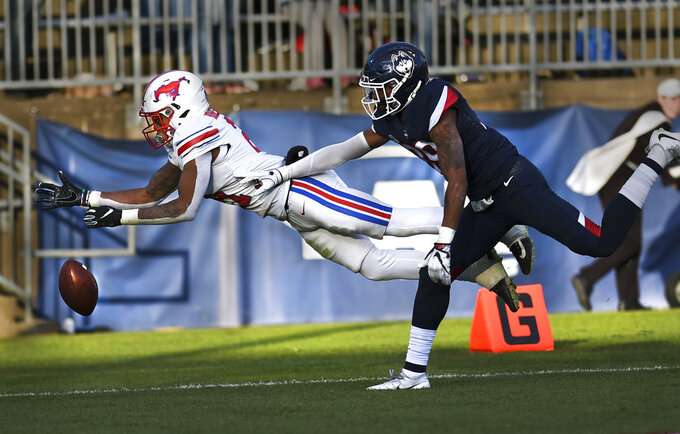 SMU running back Ke'Mon Freeman (2) misses a pass in the end zone as Connecticut defensive back Ryan Carroll (39) defends during the second half of an NCAA college football game, Saturday, Nov. 10, 2018, in East Hartford, Conn.(AP Photo/Stephen Dunn)