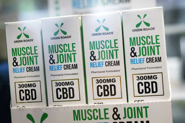 FILE - In this May 30, 2019, file photo, Muscle Joint & Relief Cream is displayed at the Cannabis World Congress & Business Exposition trade show in New York. New York regulators have proposed quality control standards and a licensing program for hemp-derived CBD products that have gained widespread popularity in products such as tinctures, salves and lotions, New York Gov. Andrew Cuomo announced Wednesday, Oct. 28, 2020. (AP Photo/Mark Lennihan, File)