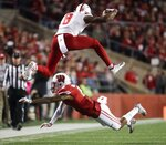 Nebraska's Stanley Morgan Jr. leaps over Wisconsin's Deron Harrell after a catch during the first half of an NCAA college football game Saturday, Oct. 6, 2018, in Madison, Wis. (AP Photo/Morry Gash)