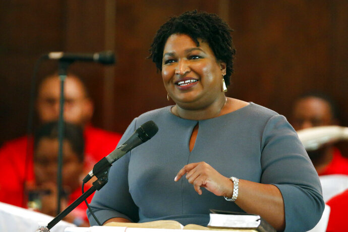 FILE - Former gubernatorial candidate and former state Rep. Stacey Abrams speaks to the congregation at Brown Chapel AME Church in Selma , Alabama, on March 1, 2020. (AP Photo/Butch Dill, File)