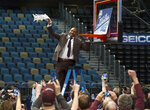THIS CORRECTS THE IDENTIFICATION OF THE PERSON CUTTING DOWN THE NET TO MONTANA HEAD COACH TRAVIS DECUIRE, NOT EASTERN WASHINGTON COACH STANTAY LEGANS - Montana head coach Travis DeCuire cuts down the net after a win over Eastern Washington in the Big Sky Championship NCAA college basketball game in Reno, Nev., Saturday, March 10, 2018. (AP Photo/Tom R. Smedes)