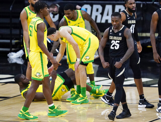 Colorado guard McKinley Wright IV, right, flexes after drawing a foul against Oregon during the second half of an NCAA college basketball game Thursday, Jan. 7, 2021, in Boulder, Colo. Colorado won 79-72. (AP Photo/David Zalubowski)