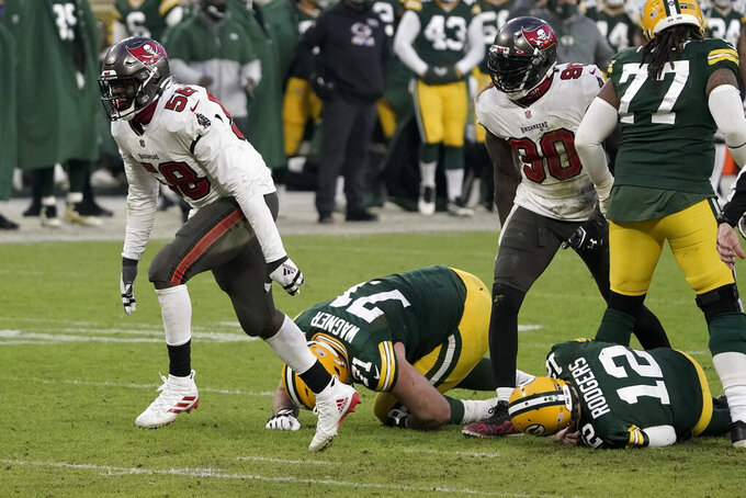 Tampa Bay Buccaneers' Shaquil Barrett (58) celebrates after sacking Green Bay Packers quarterback Aaron Rodgers (12) during the second half of the NFC championship NFL football game in Green Bay, Wis., Sunday, Jan. 24, 2021. (AP Photo/Morry Gash)