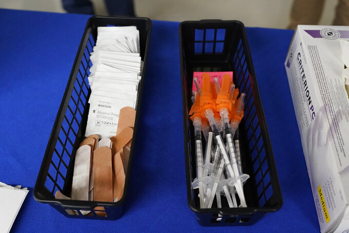 Prepped vaccine filled syringes are at ready for use at a COVID-19 vaccination site at Jackson State University in Jackson, Miss., prior to a visit by First Lady Jill Biden, Tuesday, June 22, 2021, as part of the Biden administration's nationwide tour to reach Americans who haven't been vaccinated and to promote vaccine education. (AP Photo/Rogelio V. Solis)