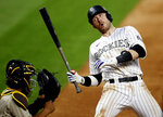 Colorado Rockies' Trevor Story, right, reacts to an inside pitch as San Diego Padres catcher Francisco Mejia fields the throw from relief pitcher Cal Quantrill in the sixth inning of a baseball game Saturday, Aug. 1, 2020, in Denver. (AP Photo/David Zalubowski)