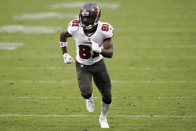 Tampa Bay Buccaneers wide receiver Antonio Brown (81) runs a route against the Carolina Panthers during the second half of an NFL football game, Sunday, Nov. 15, 2020, in Charlotte , N.C. (AP Photo/Gerry Broome)