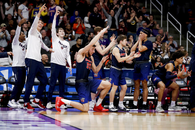 Liberty celebrates during the second half of a first round game against Mississippi State in the NCAA men's college basketball tournament Friday, March 22, 2019, in San Jose, Calif. (AP Photo/Ben Margot)
