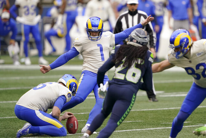 Los Angeles Rams kicker Matt Gay (1) boots a field goal as Johnny Hekker (6) holds during the first half of an NFL wild-card playoff football game against the Seattle Seahawks, Saturday, Jan. 9, 2021, in Seattle. (AP Photo/Ted S. Warren)