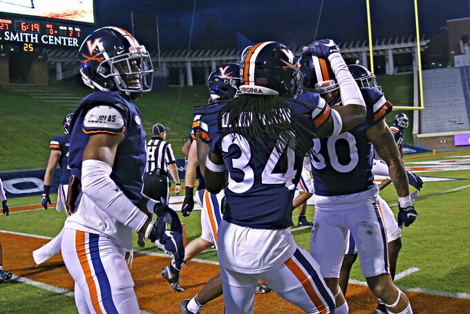 Virginia players celebrate during an NCAA college football game against Abilene Christian on Saturday, Nov. 21, 2020, in Charlottesville, Va. (Erin Edgerton/The Daily Progress via AP)