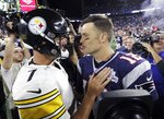 Pittsburgh Steelers quarterback Ben Roethlisberger, left, and New England Patriots quarterback Tom Brady speak at midfield after an NFL football game, Sunday, Sept. 8, 2019, in Foxborough, Mass. (AP Photo/Steven Senne)