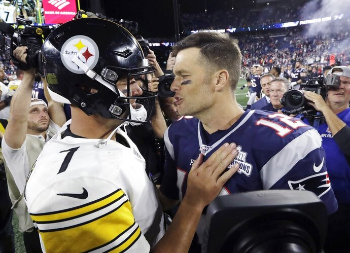Pittsburgh Steelers quarterback Ben Roethlisberger, left, and New England Patriots quarterback Tom Brady speak at midfield after an NFL football game, Sunday, Sept. 8, 2019, in Foxborough, Mass. (AP Photo/Steven Senne)