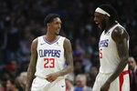 Los Angeles Clippers' Lou Williams, left, and Montrezl Harrell celebrate a basket made by Williams during the second half of an NBA basketball game against the Boston Celtics, Monday, March 11, 2019, in Los Angeles. The Clippers won 140-115. (AP Photo/Jae C. Hong)
