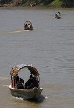 Migrants cross the Usumacinta River aboard motor boats into Mexico from Guatemala, in Frontera Corozal, Chiapas state, Mexico, Wednesday, March 24, 2021. (AP Photo/Eduardo Verdugo)