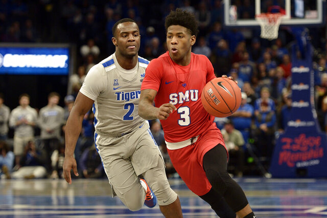 Southern Methodist guard Kendric Davis (3) handles the ball ahead of Memphis guard Alex Lomax (2) in the first half of an NCAA basketball game Saturday, Jan. 25, 2020, in Memphis, Tenn. (AP Photo/Brandon Dill)