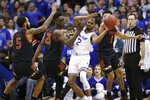 Seton Hall guard Anthony Nelson (2) passes around Maryland guard Eric Ayala (5) and forward Jalen Smith (25) during the first half of an NCAA college basketball game, Thursday, Dec. 19, 2019, in Newark, N.J. (AP Photo/Kathy Willens)