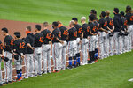 Baltimore Orioles players line up on their baseline before a baseball game against the Toronto Blue Jays in Buffalo, N.Y., Friday, Aug. 28, 2020. All players and coaches wore No. 42 uniforms in honor of Jackie Robinson Day around the league. (AP Photo/Adrian Kraus)