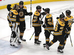Boston Bruins goaltender Tuukka Rask (40) is congratulated after a win against the Columbus Blue Jackets in Game 5 of an NHL hockey second-round playoff series, Saturday, May 4, 2019, in Boston. (AP Photo/Charles Krupa)