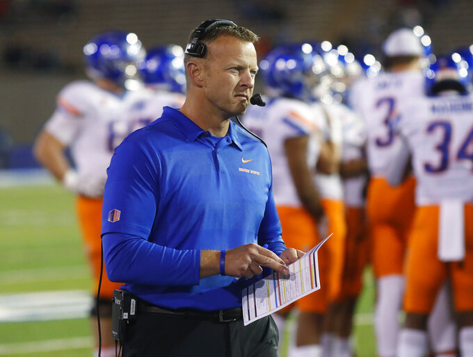 Boise State head coach Bryan Harsin checks over his play sheet in the second half of an NCAA college football game against Air Force, Saturday, Oct. 27, 2018, at Air Force Academy, Colo. Boise State won 48-38. (AP Photo/David Zalubowski)