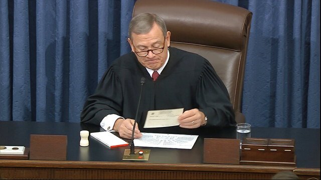 In this image from video, presiding officer Chief Justice of the United States John Roberts reads a question during the impeachment trial against President Donald Trump in the Senate at the U.S. Capitol in Washington, Wednesday, Jan. 29, 2020. (Senate Television via AP)