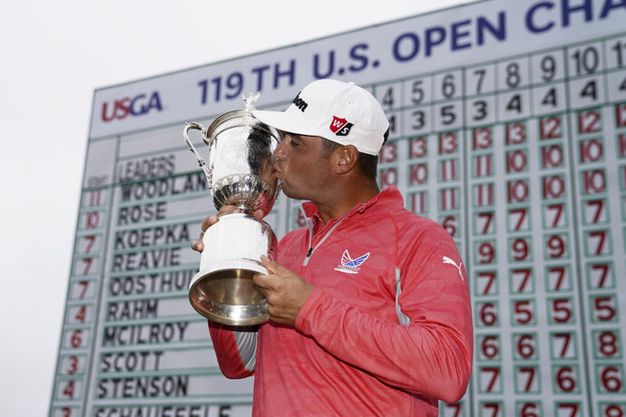 Gary Woodland posses with the trophy after winning the U.S. Open Championship golf tournament Sunday, June 16, 2019, in Pebble Beach, Calif. (AP Photo/Carolyn Kaster)
