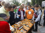 Children look at personal items found on the site of the Babi Yar tragedy at a menorah monument close to a Babi Yar ravine where tens of thousands of Jews were killed during WWII, in Kyiv, Ukraine, Tuesday, Sept. 29, 2020. Ukraine marked the 79th anniversary of the 1941 Babi Yar massacre. (AP Photo/Efrem Lukatsky)