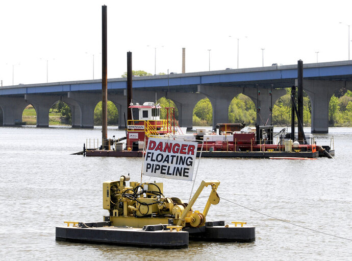 FILE - In this May 14, 2012 file photo, Brennan dredging units work on the Fox River near Ashwaubenon, Wis., as part of the PCB removal project. A bipartisan, $10 million package of more than a dozen bills designed to combat groundwater contamination in Wisconsin is slated for approval in the state Assembly. The proposals up for a vote Tuesday, Feb. 18, 2020, contain the recommendations from a water quality task force called to address growing concerns about groundwater contamination in the state. (H. Marc Larson/The Green Bay Press-Gazette via AP, File)