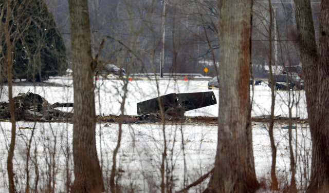 The wreckage of a UH-60 Black Hawk medical evacuation helicopter sits in a field in Mendon, NY., Thursday, Jan. 21, 2021. Three National Guard members were killed in the crash Wednesday evening Jan. 20. (Tina MacIntyre-Yee/Democrat & Chronicle via AP)