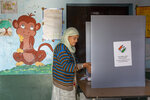 A voter casts her ballot in a bypoll for an assembly seat in Dharmsala, India, Monday, Oct. 21, 2019.  The seat was vacated by Kishan Kapoor, a Bharatiya Janata Party member of legislative assembly , who was elected to the Lok Sabha in May as Voting is underway in two Indian states of Maharashtra in the west and Haryana in the north where the Hindu nationalist Bharatiya Janata Party (BJP) headed by prime minister Narendra Modi is trying to win a second consecutive term.  (AP Photo/Ashwini Bhatia)