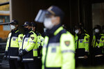 South Korean police officers wearing face masks as a precaution against the coronavirus, stand guard in Seoul, South Korea, Friday, Oct. 30, 2020. (AP Photo/Lee Jin-man)