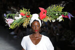 A model wears a creation from the Angela Brito collection during Sao Paulo Fashion Week in Sao Paulo, Brazil, Wednesday, Oct. 16, 2019. (AP Photo/Nelson Antoine)