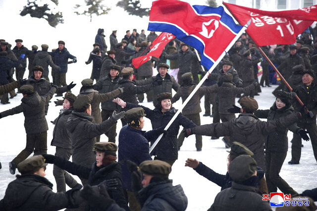 """In this Monday, Dec. 2, 2019, photo provided Tuesday, Dec. 3, 2019, by the North Korean government, people dance to celebrate the completion of Samjiyon city. On Monday, North Korean leader Kim Jong Un visited Samjiyon county at the foot of Mount Paektu to attend a ceremony marking the completion of work that has transformed the town to """"an epitome of modern civilization,"""" KCNA said. It said the town has a museum on the Kim family, a ski slope, cultural centers, a school, a hospital and factories.  Independent journalists were not given access to cover the event depicted in this image distributed by the North Korean government. The content of this image is as provided and cannot be independently verified. Korean language watermark on image as provided by source reads:"""