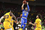 UCLA's Tyger Campbell (10) shoots in front of Arizona State's Romello White (23), Jalen House (10) and Taeshon Cherry (23) during the first half of an NCAA college basketball game Thursday, Feb. 6, 2020, in Tempe, Ariz. (AP Photo/Darryl Webb)