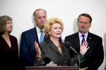 Sen. Debbie Stabenow, D-Mich., center, accompanied by Rep. Dan Kildee, D-Mich., second from left, Sen. Gary Peters., D-Mich., right, and Elizabeth Whelan, the sister of Paul Whelan, left, speaks at a news conference on Capitol Hill in Washington, Thursday, Sept. 12, 2019, to call on Congress to pass a resolution condemning the Russian government for detaining Paul Whelan. (AP Photo/Andrew Harnik)