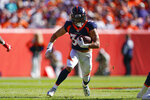 Denver Broncos running back Phillip Lindsay runs with the ball during the first half of an NFL football game against the Tennessee Titans, Sunday, Oct. 13, 2019, in Denver. (AP Photo/Jack Dempsey)