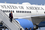 President Donald Trump exits Air Force One as he arrives at Burke Lakefront Airport in Cleveland, Ohio, Thursday, Aug. 6, 2020. (AP Photo/Susan Walsh)