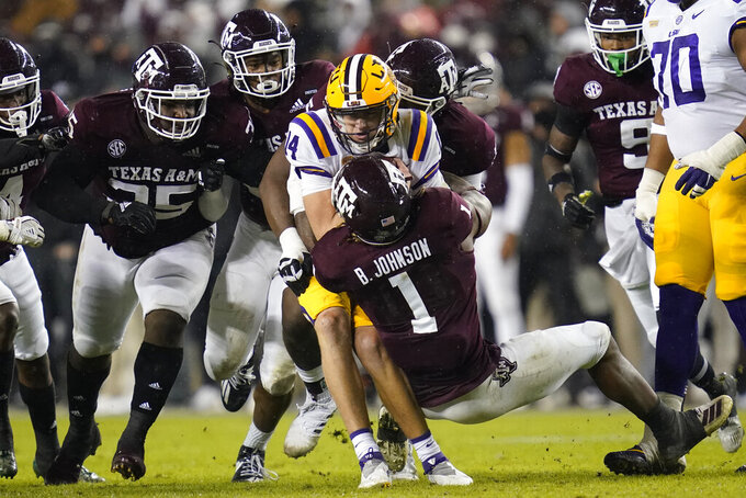 Texas A&M linebacker Buddy Johnson (1) sacks LSU quarterback Max Johnson (14) during the first half of an NCAA college football game, Saturday, Nov. 28, 2020. in College Station, Texas. (AP Photo/Sam Craft)