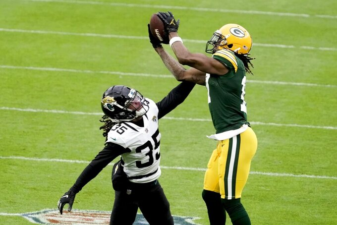 Jacksonville Jaguars' Sidney Jones breaks up a pass intended for Green Bay Packers' Davante Adams during the first half of an NFL football game Sunday, Nov. 15, 2020, in Green Bay, Wis. (AP Photo/Morry Gash)
