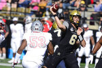 Vanderbilt quarterback Riley Neal (6) throws downfield against UNLV in the first half of an NCAA college football game Saturday, Oct. 12, 2019, in Nashville, Tenn. (AP Photo/Mike Strasinger)