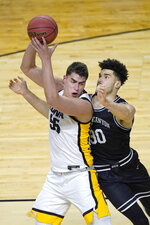 Iowa's Luka Garza (55) is pressured by Grand Canyon's Gabe McGlothan during the first half of a first round NCAA college basketball tournament game Saturday, March 20, 2021, at the Indiana Farmers Coliseum in Indianapolis. (AP Photo/Charles Rex Arbogast)