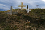 Crosses placed by pilgrims of St. James Way are seen in Roncesvalles, northern Spain, Friday, April 9, 2021 photo. The pilgrims are trickling back to Spain's St. James Way after a year of being kept off the trail due to the pandemic. Many have committed to putting their lives on hold for days or weeks to walk to the medieval cathedral in Santiago de Compostela in hopes of healing wounds caused by the coronavirus. (AP Photo/Alvaro Barrientos)
