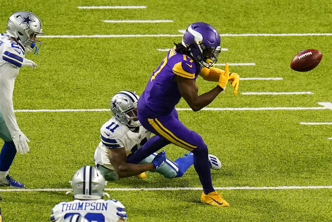 Minnesota Vikings wide receiver K.J. Osborn fumbles as he is hit by Dallas Cowboys' Cedrick Wilson (11) during a punt return in the first half of an NFL football game, Sunday, Nov. 22, 2020, in Minneapolis. (AP Photo/Charlie Neibergall)