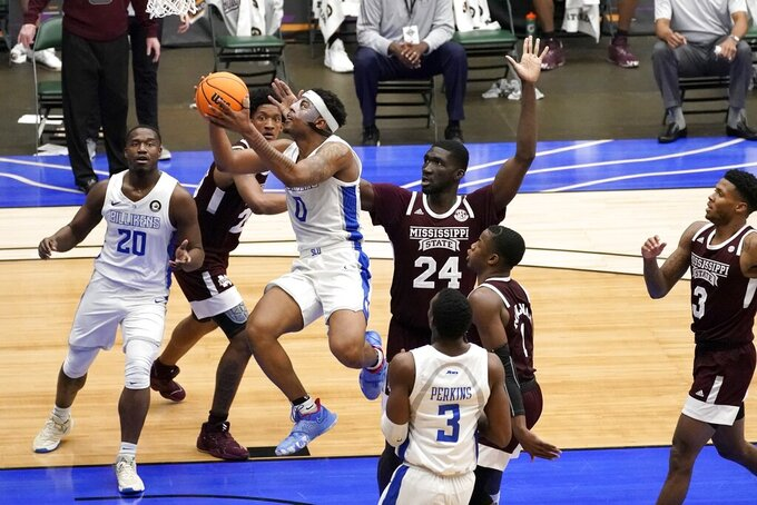 Saint Louis guard Jordan Goodwin (0) goes up for a shot after getting past the defense of Mississippi State forward Abdul Ado (24) during the first half of an NCAA college basketball game in the first round of the NIT Tournament, Saturday, March 20, 2021, in Frisco, Texas. (AP Photo/Tony Gutierrez)